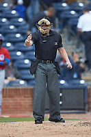 Home plate umpire Richard Riley makes a strike call during the International League game between the Buffalo Bison and the Durham Bulls at Durham Bulls Athletic Park on April 25, 2018 in Allentown, Pennsylvania.  The Bison defeated the Bulls 5-2.  (Brian Westerholt/Four Seam Images)