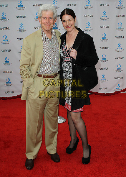 Tony Roberts and Guest.2012 TCM Classic Film Festival Opening Night Gala Held at Grauman's Chinese Theatre, Hollywood, California, USA..April 12th, 2012.full length black suit dress  beige grey gray print .CAP/ADM/KB.©Kevan Brooks/AdMedia/Capital Pictures.