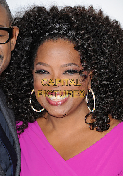 Oprah Winfrey<br /> &quot;Lee Daniels' The Butler&quot; Los Angeles Premiere held at Regal Cinemas L.A. Live, Los Angeles, California, USA.        <br /> August 12th, 2013    <br /> headshot portrait pink hoop earrings smiling <br /> CAP/DVS<br /> &copy;DVS/Capital Pictures
