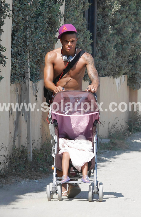 **ALL ROUND EXCLUSIVE PICTURES FROM SOLARPIX.COM**.**WORLDWIDE SYNDICATION RIGHTS**.Pics show Spurs footballer Jermaine Jenas storming off with his daughter Sancha Natasha, after an argument with girlfriend Ellie Penfold in Puerto Banus, Marbella. The couple were seen shouting at each other after a day out at  Buddha Beach Bar before Jermaine decided to march off with sleeping daughter in buggy..This pic:    Jermaine Jenas & Ellie Penfold.JOB REF:      11353   AB1        DATE:   29.05.10.**MUST CREDIT SOLARPIX.COM OR DOUBLE FEE WILL BE CHARGED**.**MUST AGREE FEE BEFORE ONLINE USAGE**.**CALL US ON: +34 952 811 768 or LOW RATE FROM UK 0844 617 7637**