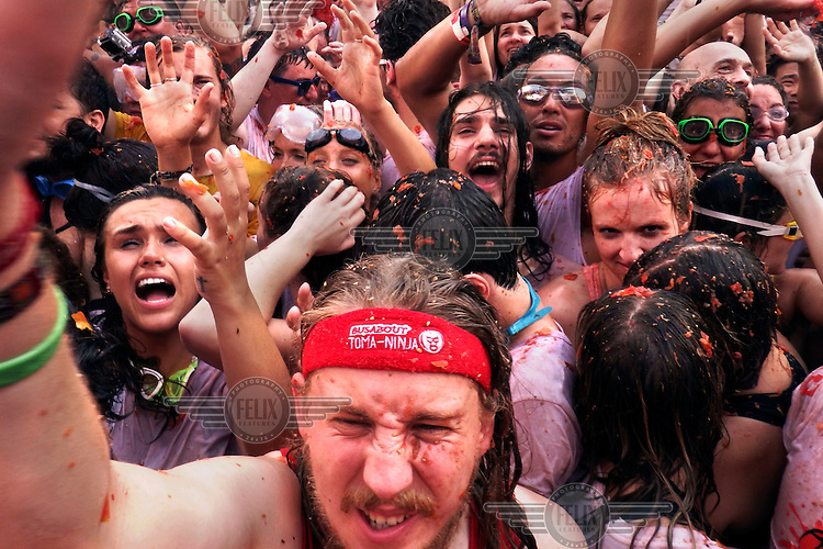 Participants in La Tomatina call for more supplies so they can continue the food fight. The annual event began in the mid 1940s and, although its inspiration is unclear, it has since grown to become known as 'The World's Biggest Food Fight'. 100 metric tonnes, brought in by four lorries, of the fruits are thrown during the event. La Tomatina has grown into an international festival, attracting people from around the world. Over the years, however, its growing popularity has meant greater regulation and it is now limited to 20,000 participants.