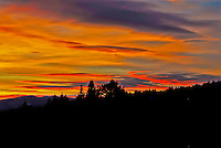 Looking like fire in the sky the sun sets over the Kootenai National Forest in Montana.