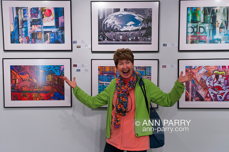 Massapequa, New York, USA. September 18, 2014. Artist HOLLAY GORDON is by her Beyond Photography during Studio 5404 Art Space opening reception for art show Taking it to the Street. The show featured new works by emerging and up-and-coming local and New York artists.