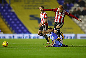 1st November 2017, St. Andrews Stadium, Birmingham, England; EFL Championship football, Birmingham City versus Brentford; Ryan Woods of Brentford leaps the challenge from David Davis of Birmingham City