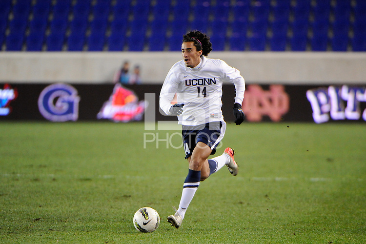 Tony Cascio (14) of the Connecticut Huskies. Connecticut defeated Louisville 1-0 during the first semifinal match of the Big East Men's Soccer Championships at Red Bull Arena in Harrison, NJ, on November 11, 2011.