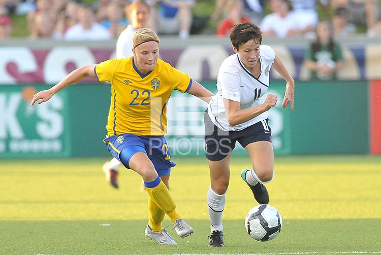 Megan Rapinoe #11, Annica Svensson...USWNT tied Sweden 1-1 at Morrison Stadium, Omaha Nebraska.