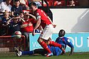 Patrick Agyemang of Stevenage (on loan from QPR) challenges Andy Butler of Walsall. - Walsall v Stevenage - npower League 1 - Banks's Stadium, Walsall - 24th March, 2012  .© Kevin Coleman 2012