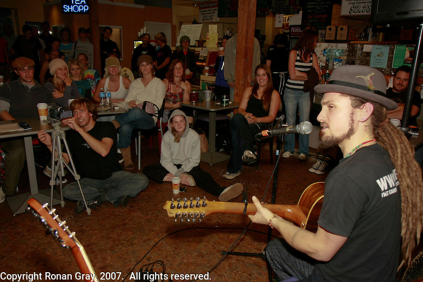 John Butler performs to a packed coffee house during an impromptu gig in Ocean Beach California, November 30 2007.   Butler and Brett Dennen were both supposed to perform after a beach clean-up sponsored by the San Diego CoastKeeper and the local chapter of the Surfrider Foundation.  Heavy rain forced the organizers to cancel the clean-up but Butler and Dennen agreed to play at Newbreak Cafe, a small coffee shop near the beach where the clean-up was supposed to have been held.