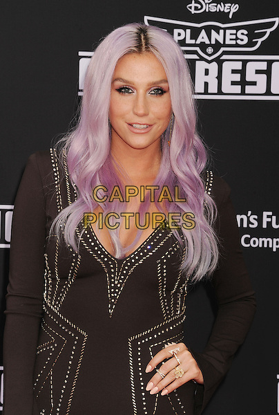 HOLLYWOOD, CA- JULY 15: Singer Kesha arrives at the Los Angeles premiere of Disney's 'Planes: Fire &amp; Rescue' at the El Capitan Theatre on July 15, 2014 in Hollywood, California.<br /> CAP/ROT/TM<br /> &copy;Tony Michaels/Roth Stock/Capital Pictures