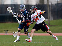 Ryder Bohlander (34) of Maryland gets tangled up with Jacob Bock (44) of Penn at Ludwig Field in College Park, Maryland.