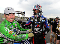 Jul, 22, 2012; Morrison, CO, USA: NHRA top fuel dragster driver Antron Brown (right) celebrates with teammate Jack Beckman after winning the Mile High Nationals at Bandimere Speedway. Mandatory Credit: Mark J. Rebilas-US PRESSWIRE