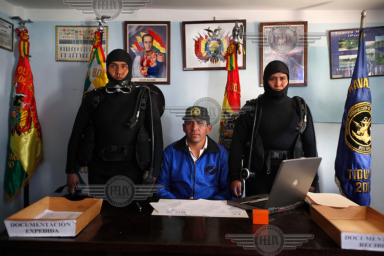 From left, Alferez Tito, Juan Carlos Barrios, Marcelo Tarquino, scuba experts at the Tiquina Bolivian Navy Base on Lake Titicaca. Bolivia lost what is now northern Chile in a war over nitrates leaving Bolivia without access to the ocean.