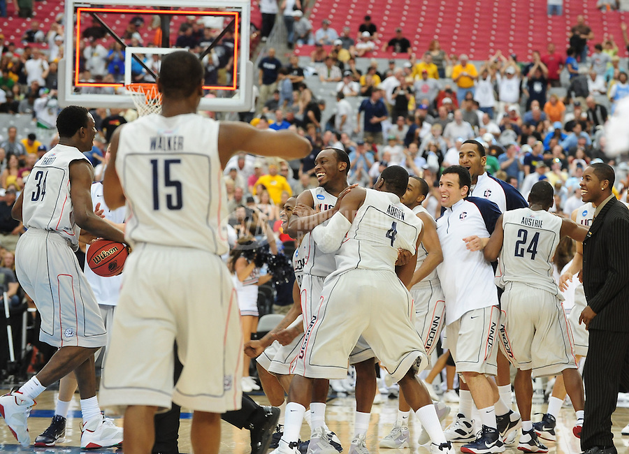 Mar 28, 2009; Glendale, AZ, USA; The Connecticut Huskies after defeating the Missouri Tigers during the finals of the west regional in the 2009 NCAA mens basketball tournament at the University of Phoenix Stadium. The Huskies defeated the Tigers 82-75 to advance to the final four. Mandatory Credit: Mark J. Rebilas-