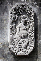 Jatiluwih, Bali, Indonesia.  Stone-carved Deity Decorating Wall of Temple Courtyard.   Luhur Bhujangga Waisnawa Hindu Temple.