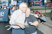 Democratic presidential candidate and Vermont senator Bernie Sanders greets people as he marches in the Labor Day Parade in Milford, New Hampshire, on Mon., September 2, 2019. Candidates Bernie Sanders and Vermin Supreme were the only candidates who marched in the parade this year.