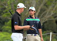 Nick Voke (NZ, left) talks to Harrison Endycott (Aus) on day one of the 2017 Asia-Pacific Amateur Championship day one at Royal Wellington Golf Club in Wellington, New Zealand on Thursday, 26 October 2017. Photo: Dave Lintott / lintottphoto.co.nz