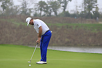 Graeme McDowell (NIR) putts on the 17th green during Saturay's Round 3 of the 2014 BMW Masters held at Lake Malaren, Shanghai, China. 1st November 2014.<br /> Picture: Eoin Clarke www.golffile.ie