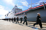 """Navy sailors run alongside the ship after a """"bring her to life"""" order was issued during the commissioning ceremony for the USS Green Bay in Long Beach, Calif., on Jan. 24, 2009."""