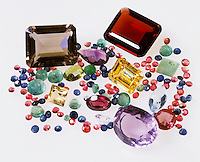 ASSORTMENT OF GEMSTONES<br /> aquamarine (light blue),  ruby &amp; garnet (red), sapphire &amp; tanzanite (blue), emerald (green), tourmaline(pink), citrine (brown) ,amethyst (purple)