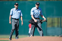 Home plate umpire Mike Snover and base umpire Emil Jimenez during the South Atlantic League game between the Asheville Tourists and the Kannapolis Intimidators at Kannapolis Intimidators Stadium on May 7, 2017 in Kannapolis, North Carolina.  The Tourists defeated the Intimidators 4-1.  (Brian Westerholt/Four Seam Images)