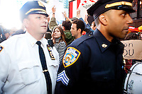 "Police officers are forced to retreat after failing to control a crowd of protesters with ""Occupy Wall Street"" at Times Square on October 15, 2011 in New York City.  While crowd estimates numbered in the tens of thousands, police tactics (including nets, motor scooters, barricades, arrests, and intimidation by riders on horseback) prevented the crowd, which had been split up, from joining together as one in the middle of Times Square."