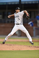 Asheville Tourists starting pitcher Konner Wade #11 delivers a pitch during a game against the Hagerstown Sun at McCormick Field on September 8, 2014 in Asheville, North Carolina. The Tourists defeated the Suns 16-7. (Tony Farlow/Four Seam Images)