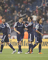 New England Revolution midfielder Marko Perovic (29) celebrates his goal with teammates. In a Major League Soccer (MLS) match, the New England Revolution defeated Sporting Kansas City, 3-2, at Gillette Stadium on April 23, 2011.
