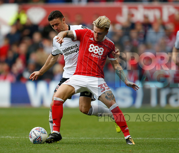 Jason Cummings of Nottingham Forest tussles with Enda Stevens of Sheffield Utd  during the Championship match at the City Ground Stadium, Nottingham. Picture date 30th September 2017. Picture credit should read: Simon Bellis/Sportimage