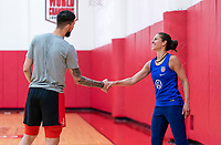 HOUSTON, TX - FEBRUARY 1: Carli Lloyd #10 of the United States shakes hands with Austin Rivers at Houston Rockets Training Center on February 1, 2020 in Houston, Texas.