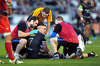 Francois Louw of Bath Rugby is treated for an injury during a break in play. European Rugby Champions Cup match, between RC Toulon and Bath Rugby on January 10, 2016 at the Stade Mayol in Toulon, France. Photo by: Patrick Khachfe / Onside Images