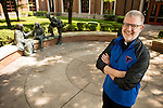 The Rev. Dennis H. Holtschneider, C.M., president of DePaul University, is seen in a portrait in Saint Vincent's Circle on DePaul's Lincoln Park campus Monday June 29, 2015. (DePaul University/Jeff Carrion)