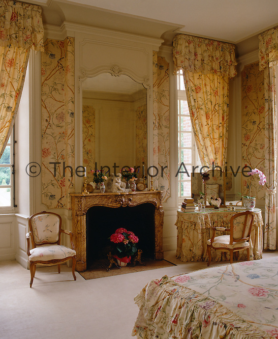 This feminine bedroom has been decorated in chintz, a legacy of the previous owner