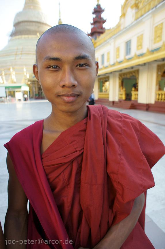 young monk in maroon-colored robe, Shwedagon pagoda complex, Yangon, Myanmar, 2011