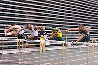 Competitors in the first of 2 sections in the 60 hurdles final clear the final hurdle at the 2012 MIAA Indoor Track & Field Championships at Missouri Southern in Joplin, Sunday, February 26.
