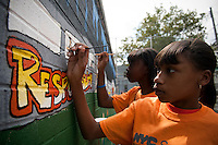 Students paint a mural against bullying at a middle school in the Richmond Hill neighborhood in the borough of Queens in New York on Friday, August 13, 2010  (© Frances M. Roberts)