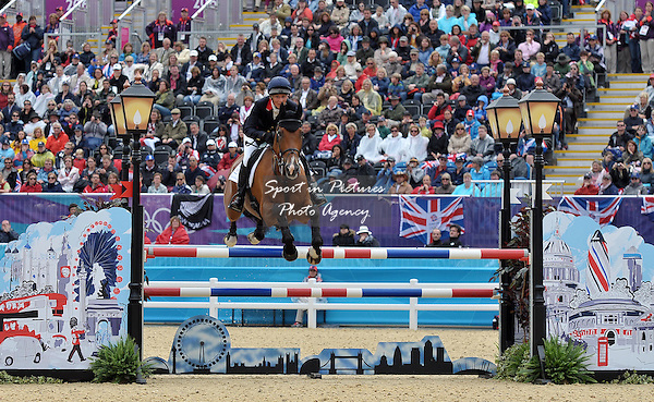 Mary King (GBR) jumps the last fence. Equestrian Eventing - PHOTO: Mandatory by-line: Garry Bowden/SIP/Pinnacle - Photo Agency UK Tel: +44(0)1363 881025 - Mobile:0797 1270 681 - VAT Reg No: 768 6958 48 - 31/07/2012 - 2012 Olympics - Greenwich, London, England.