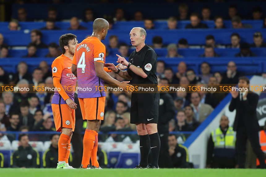 Referee Mike Dean has words with Manchester City captain, Vincent Kompany during Chelsea vs Manchester City, Premier League Football at Stamford Bridge on 5th April 2017