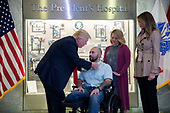 US President Donald J. Trump (L), with First Lady Melania Trump (R), awards Sergeant First Class Alvaro Barrientos (2-L), with his wife Tammy Barrientos (2-R), the Purple Heart to him during a visit to Walter Reed National Military Medical Center in Bethesda, Maryland, USA, 22 April 2017. Sergeant First Class Alvaro Barrientos was recently injured in Afghanistan while deployed and for the wounds he sustained, he is receiving the Purple Heart.<br /> Credit: Shawn Thew / Pool via CNP