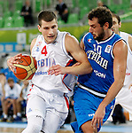 """Serbia`s Nemanja Nedovic (L) and Marco Belinelli of Italy (R) in action during European basketball championship """"Eurobasket 2013""""  basketball game for 7th place between Serbia and Italy in Stozice Arena in Ljubljana, Slovenia, on September 21. 2013. (credit: Pedja Milosavljevic  / thepedja@gmail.com / +381641260959)"""