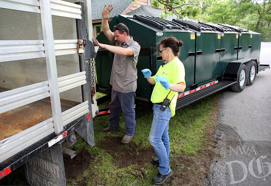 NWA Democrat-Gazette/DAVID GOTTSCHALK  Chad Henard, special waste coordinator at Boston Mountain Solid Waste Dstrict, and Kelley Bradley, recycle center, help direct Thursday, April 20, 2017, a recycling trailer into position at the facility in Prairie Grove. Waste Management Ecovista Tontitown Landfill and Boston Mountain are preparing for the Washington County 2017 Spring Cleanup event taking place today from 8:00 am to 3:00 p.m. and Saturday 8:00 am to noon. Residents can bring in items including furniture, carpet, roofing, treated lumber, vinyl siding and insulation for free. Proof of county residency is required. Other items and items above a certain amount may have a charge. The event is sponsored by the Washington County Environmental Affairs Office.
