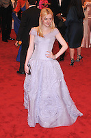 Dakota Fanning at the 'Schiaparelli And Prada: Impossible Conversations' Costume Institute Gala at the Metropolitan Museum of Art on May 7, 2012 in New York City. © mpi03/MediaPunch Inc.