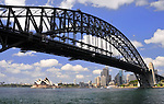 View of Sydney Harbour Bridge with city and opera house in the background.
