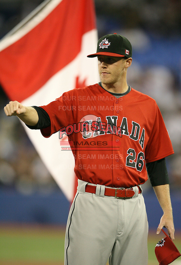 March 7, 2009:  Pitcher T.J. Burton (26) of Canada during the first round of the World Baseball Classic at the Rogers Centre in Toronto, Ontario, Canada.  Team USA defeated Canada 6-5 in both teams opening game of the tournament.  Photo by:  Mike Janes/Four Seam Images