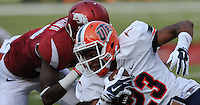 NWA Democrat-Gazette/ANDY SHUPE<br /> Arkansas' Kevin Richardson II reaches to tackle University of Texas at El Paso's Donovan Walker Saturday, Sept. 5, 2015, during the fourth quarter of play in Razorback Stadium in Fayetteville. Visit nwadg.com/photos to see more from the game.