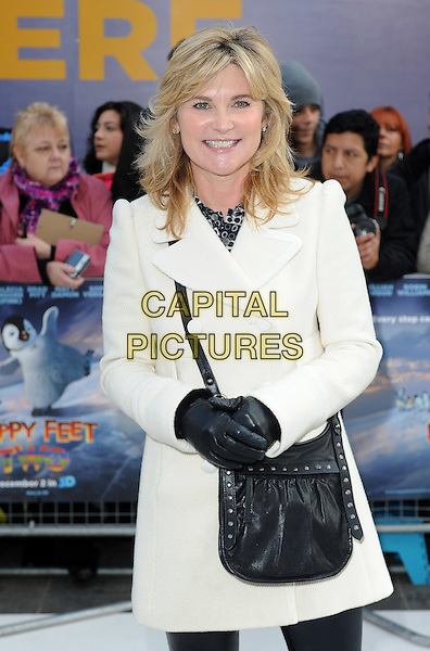 Anthea Turner.European Premiere of 'Happy Feet Two' at the Empire Leicester Square, London, England..November 20th 2011.half length coat gloves bag purse black white .CAP/BEL.©Tom Belcher/Capital Pictures.
