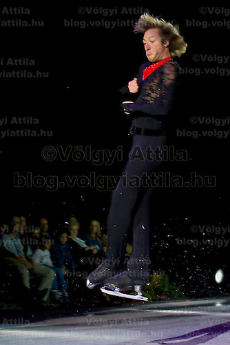 Evgeny Plushenko performs while his friend Edvin Marton plays the violin during the great opening gala at Syma Center.