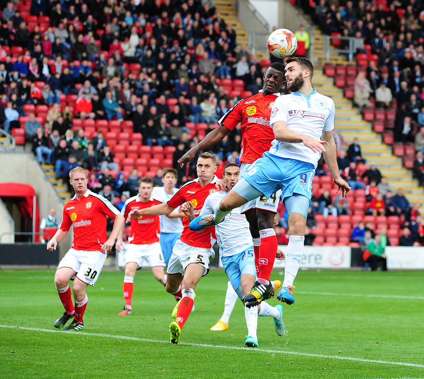 Coventry City's Josh McQuoid vies for possession with Crewe Alexandra's Greg Leigh<br /> <br /> Photographer Chris Vaughan/CameraSport<br /> <br /> Football - The Football League Sky Bet League One - Crewe Alexandra v Coventry City - Saturday 11th October 2014 - Alexandra Stadium - Crewe<br /> <br /> &copy; CameraSport - 43 Linden Ave. Countesthorpe. Leicester. England. LE8 5PG - Tel: +44 (0) 116 277 4147 - admin@camerasport.com - www.camerasport.com