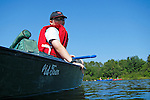 Young boy canoeing on the St. Croix River, Washingtom County, Maine, USA