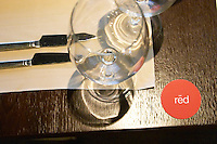 Detail of a wine glass knife and for on the table an a marker with red the name of the restaurant. The Restaurant Red at the Hotel Madero Sofitel in Puerto Madero, Buenos Aires Argentina, South America