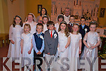 Children from Kilgobnet National school who made their first Holy Communion in Beaufort on Saturday were Ian McGillycuddy, Blaise Mangan, Eoin O'Hagan, Daniel Turc, Lorna Cahill, Laura Hayes, Tara Breen, Chloe West, Chloe Doona, Niamh O'Byrne, Rhiannon O'Donoghue and Caoimhe Griffin with teacher Una Doyle and Fr Micheal O'Dochartaigh.........